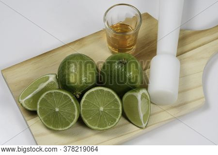 Fresh Tahiti Lemon On Wooden Board With A Drink Cup