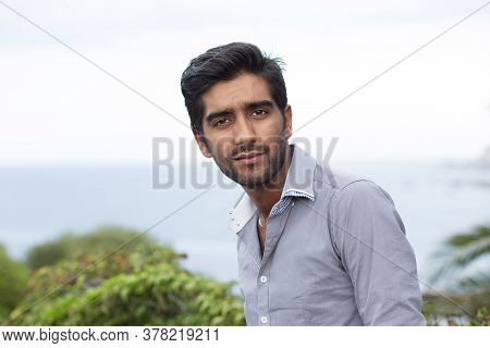 Closeup Portrait Of Stressed Unhappy Man Standing Outside Green Bushes Sea Nature Background Looking