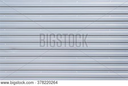 Sheet Metal With Little Texture Grey Color. Sheet Material For Metalwork Walls. Silver Iron Wall. Co