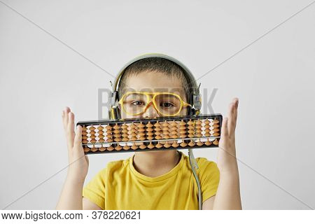 Schoolboy With Abacus. Young Kid Training Mental Arithmetic - Complex Process That Includes Number M