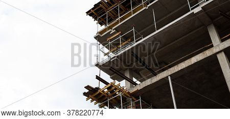 High-rise Building Under Construction. Building Site On White Background. New Multi-storey Buildings