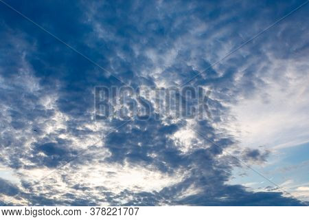 Dramatic Blue Sky With Dark Clouds At Sunset. The Concept Of Bad Weather, Depression.