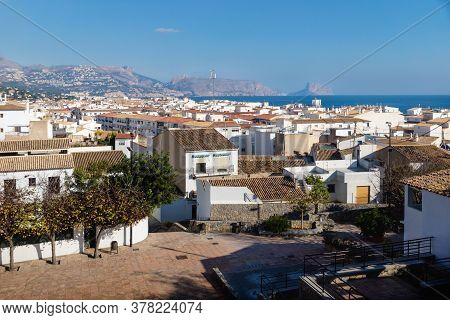 Outlook At The Old Town Square Placa Laigua With Sunny View Over Skyline And Ocean With Mountains An