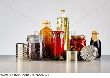 Canned Goods, Conserves, Sauces And Oils On The Table. Concept Donation Food.