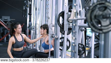 Sporty Asian Women Exercise Workout Squats At Fitness Gym With The Barbell In Smith Machine, Persona