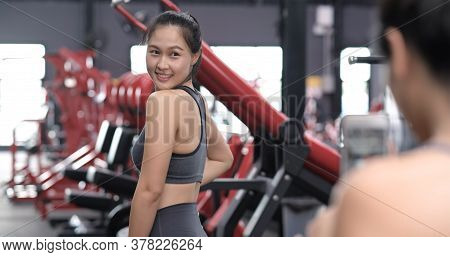 Sporty Young Asian Women With Friends Taking Picture Of Her Friend Using Mobile Phone, Females Havin