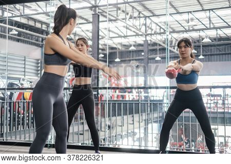 Group Asian Women Training Exercise Workout At Fitness Gym In Sportswear With Personal Trainer Coach