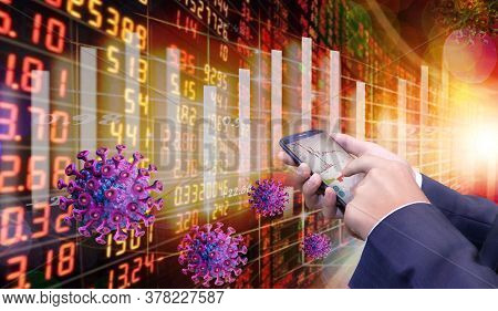 Business Man Holding Phone. The Coronavirus Sinks The Global Stock Exchanges. Smartphone App Showing