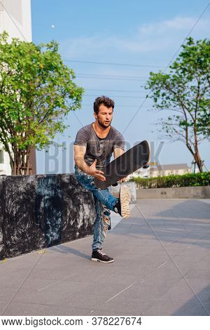 Skateboarder Doing A Skateboard Trick On The Street