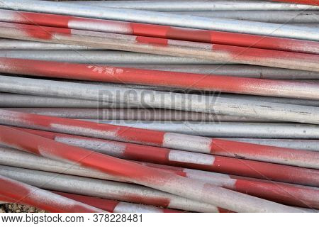 Steel Gi Pipes In The Workshop And Galvanized Steel Tubes In The Background