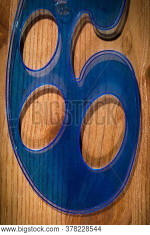 Plastic Blue Pattern On A Wooden Table