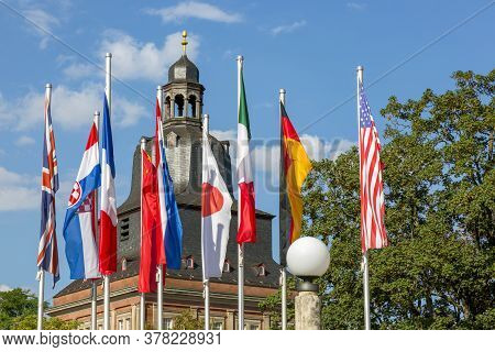 Trier, Germany - July 06, 2018: Flags Of Different Countries Near The Basilica Of The Roman Emperor