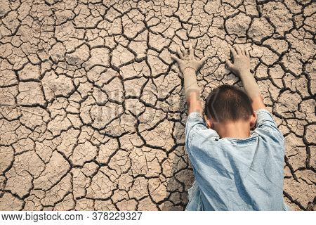 The Little Boy Waiting For Drinking Water To Live Through This Drought, Concept Drought And Crisis E