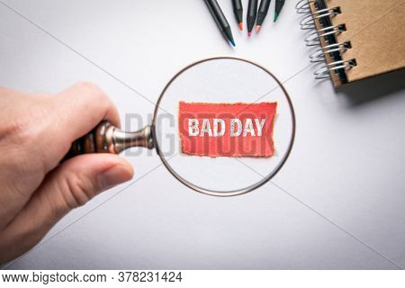 Bad Day. Business Concept. Mans Hand, Holding Magnifying Glass