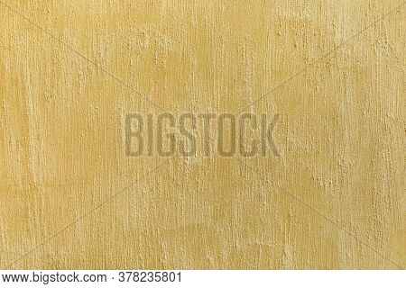 Decorative Shabby Plaster Wall In Beige Color. Concrete Scratched Texture Empty Background.