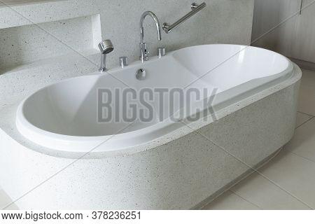 Close Up Of White Bathtub In Luxury Modern Bathroom.