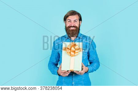 Mature Man Looking Casual In Surprise With Present Gift Box. Commonly Used For Birthday. Buy Anniver