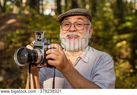 Vintage Camera. Hire Vacation Photographer. Portrait Of Joyful Elderly Man Making Photo. Nice Shot.