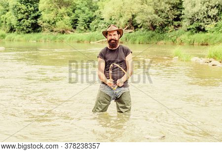 Pro Fishing. Bearded Fisher In Water. Hobby And Sport Activity. Pothunter. Fisherman With Fishing Ro