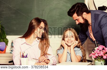 First You Start With Homework. Parents Help Daughter With Homework. Child Do Homework In Class. Happ