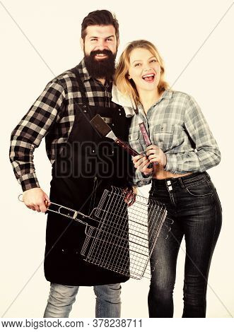 Tools For Roasting Meat Outdoors. Picnic And Barbecue. Bearded Hipster And Girl Ready For Barbecue P