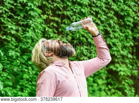 Soda Water. Water Balance. Man Bearded Tourist Drinking Water Plastic Bottle Nature Background. Thir