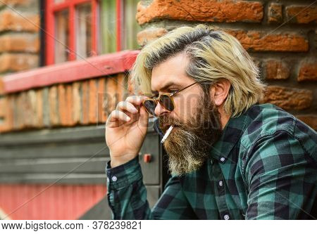Reduce Stress. Mental Health. Hipster Smoking Old Architecture Background. Medical Cannabis. Guy In