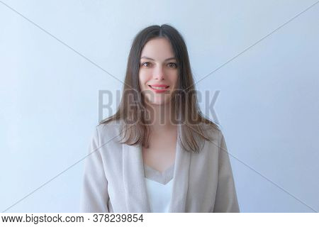Portrait Of Brunette Young Woman With Red Lips In Suit Smiling On White Background Looking At Camera