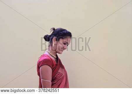 A Model Woman In A Sari Dressed In Her Customs And Religion On White Background