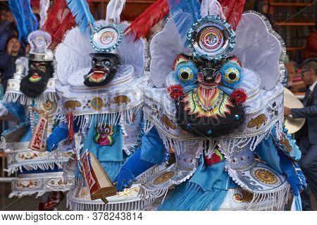 Oruro, Bolivia - February 25, 2017: Masked Morenada Dancers In Ornate Costumes Parade Through The Mi