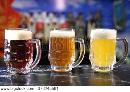 Glasses With Different Sorts Of Craft Beer. Red, Bronze And White Beer In Beer Glasses On The Bar. G