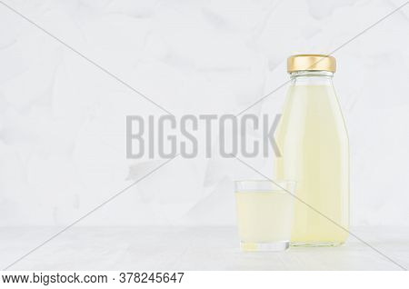 Fresh Yellow Pineapple Juice In Glass Bottle Mock Up With Wine Glass On White Wood Table In Light In