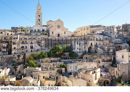 View of the typical houses of the ancient stone town of Matera (Sassi di Matera),  Basilicata, Italy. In the background Matera Cathedral.