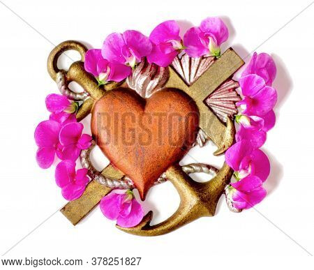 Faith Hope Love Symbol In Metal With Pink Flowers In Surrondings.