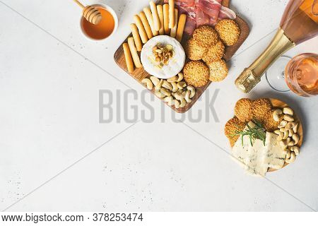 Wooden Board With Cheese, Ham, Bread Stick, Nut Cashew, Walnut And Honey On Camembert With Glasses O