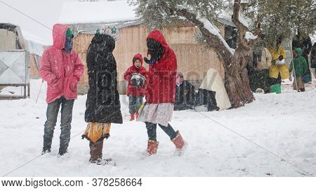 Aleppo, Syria, February 15, 2017 Refugee Children Play Snowballs In The Refugee Camp.