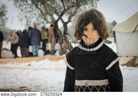 Aleppo, Syria, February 15, 2017 A Refugee Girl Looking At The Camera, Showing Signs Of Cold, Due To