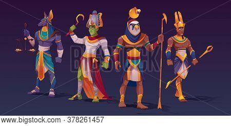 Egyptian Gods Anubis, Ra, Amon And Osiris. Ancient Egypt Deities Characters In Pharaoh Clothes Holdi