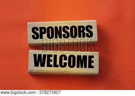 Sponsors Welcome On Wooden Blocks. Sponsorship Donation Business Concept.