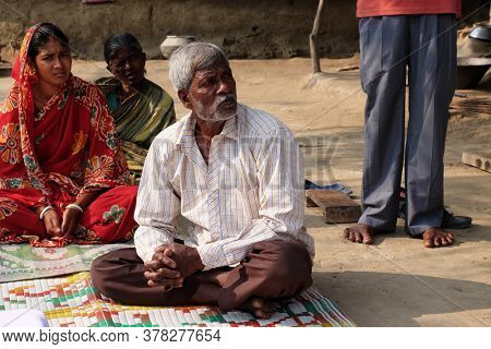 MITRAPUR, INDIA - FEBRUARY 26, 2020: Faithful Catholics during an outdoor Mass in the village of Mitrapur, West Bengal, India