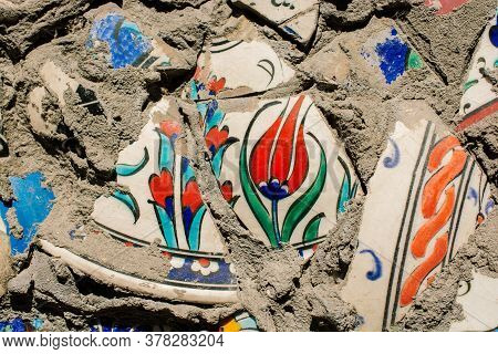 Little Cracked Fragments Of Ancient Ottoman Handmade Tiles As A Background