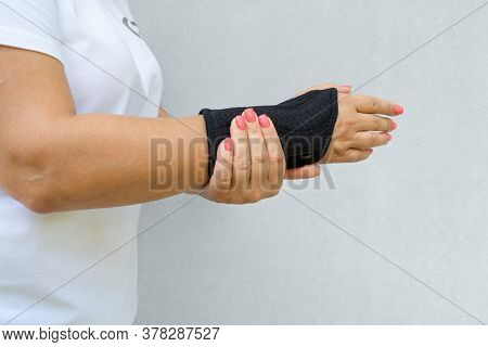 Wrist Support With Hand Isolated On Light Background. Antimicrobial Wrist Brace