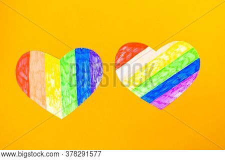 Two Hearts In Lgbtq Colors On Orange Background, Top View