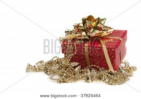 Red Giftbox With Golden Bow And Other New Year's Decoration