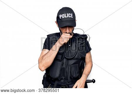 Middle age policeman wearing police uniform and bulletproof vest over white background feeling unwell and coughing as symptom for cold or bronchitis. Health care concept.