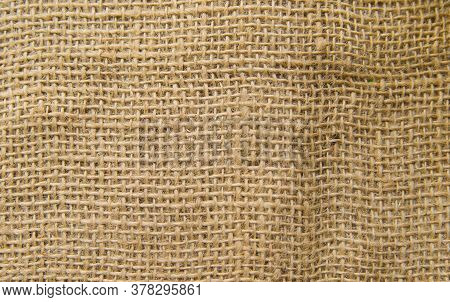 Burlap Fabric, Cotton Fabric Close-up Beige And Brown, With Space For Text.the Texture Of The Fabric
