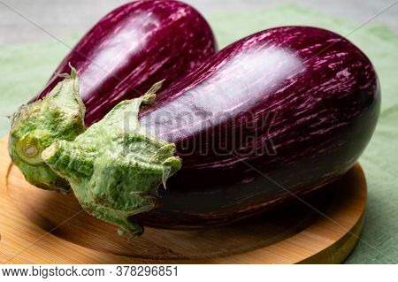 Fresh Uncooked Graffiti Or Sicilian Eggplants Vegetables With Purple And White Stripes Close Up