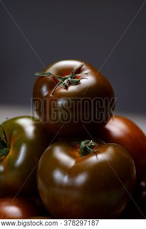 Fresh Ripe Sweet Reddish Brown And Green Kumato Tomatoes Close Up