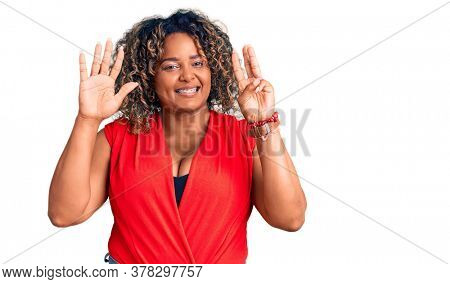 Young african american plus size woman wearing casual style with sleeveless shirt showing and pointing up with fingers number eight while smiling confident and happy.