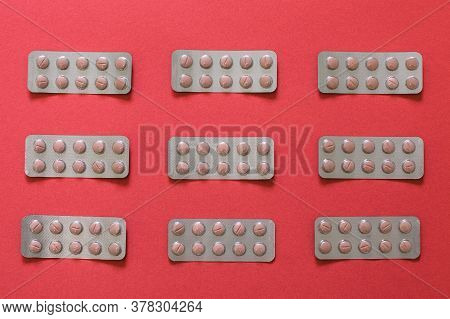 Medicament In Blister On Table With Red Background